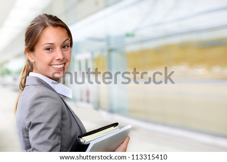 Portrait of beautiful businesswoman standing outside building - stock photo