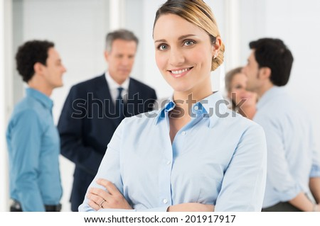 Portrait Of Beautiful Businesswoman Standing With Arm Crossed
