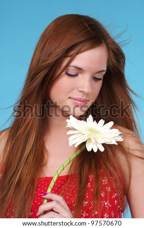 Portrait of beautiful cacuacsian woman with white flower - stock photo