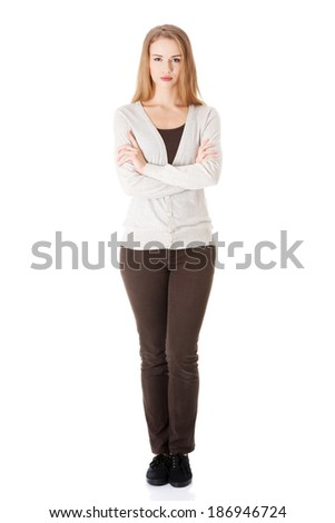Portrait of beautiful casual serious woman. Isolated on white. - stock photo