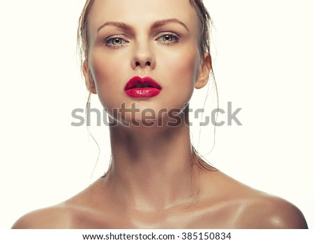 Portrait of beautiful caucasian blonde woman with red lips isolated on white background. Toned - stock photo