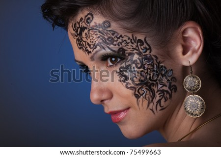 Portrait of beautiful caucasian young woman. Fashionable make-up.