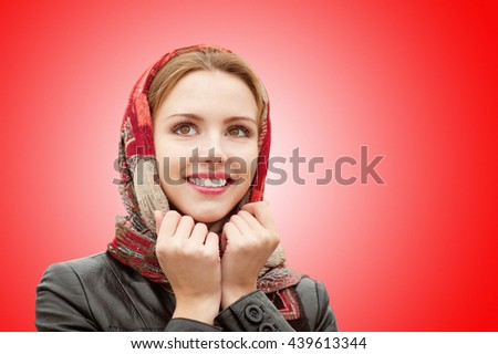 Portrait of beautiful charming smiling woman isolated on red background.