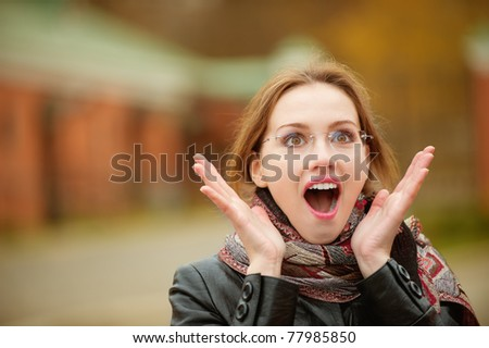 Portrait of beautiful charming woman in shock.