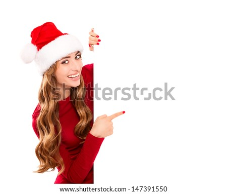 Portrait of beautiful christmas woman in Santa Claus costume with empty blank board - stock photo