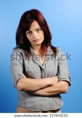 Portrait of  Beautiful confident woman with serious expression - stock photo