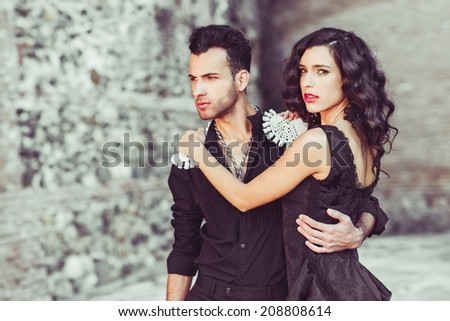 Portrait of beautiful couple, models of fashion, wearing spanish clothes - stock photo