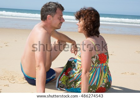 Portrait of beautiful couple touching heads, looking at each other and smiling
