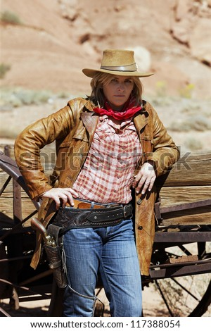 Portrait of beautiful cowgirl. Western movie style - stock photo