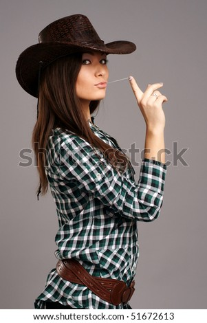 Portrait of beautiful cowgirll in hat - stock photo