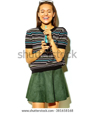 portrait of beautiful crazy smiling brunette woman girl in casual hipster summer clothes with no makeup isolated on white drinking soda from bottle with straw - stock photo