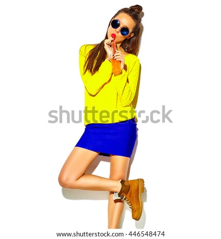 portrait of beautiful crazy smiling brunette woman girl in casual hipster summer colorful clothes with red lips isolated on white drinking soda from bottle with straw in sunglasses