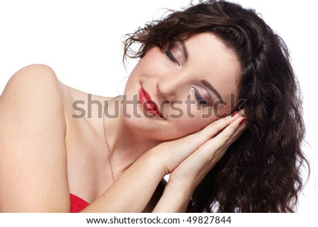 portrait of beautiful curly brunette laying her head on closed hands, like she is sleeping