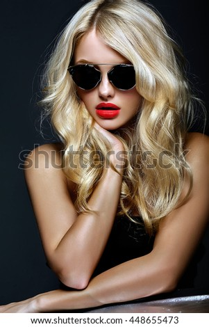 portrait of beautiful cute blonde woman girl in sunglasses with red lips