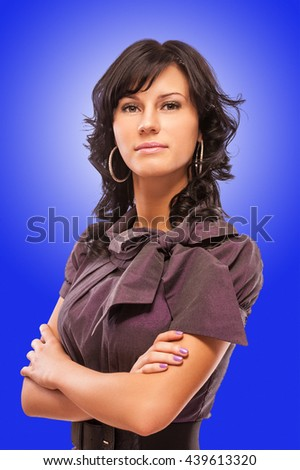 Portrait of beautiful dark-haired young woman, on blue background. - stock photo