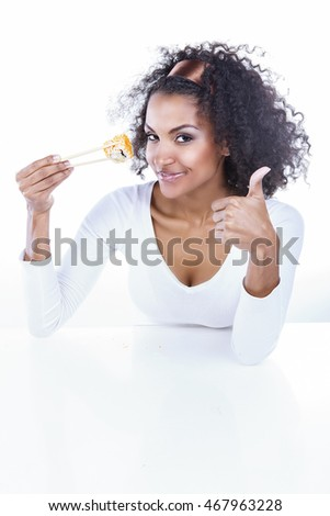 Portrait of beautiful dark-skinned girl with the land holding chopsticks on white background