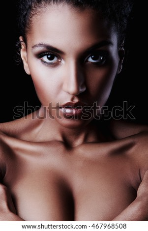 Portrait of beautiful dark-skinned Nude girl