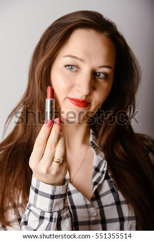 portrait of beautiful delicate brunette woman with red lipstick