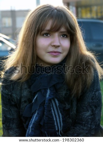 Portrait of beautiful dreaming girl, close-up. - stock photo