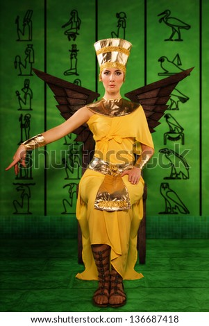 Portrait of beautiful egyptian woman in costume of the Pharaoh - stock photo