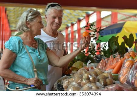 Portrait of beautiful elderly couple in  market - stock photo