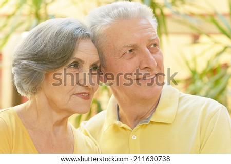 Portrait of beautiful elderly couple outdoor in summer park