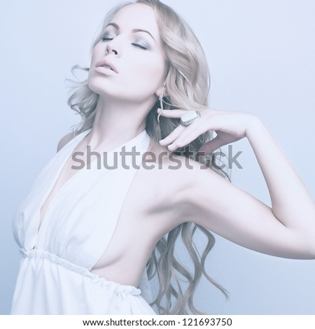 portrait of beautiful elegant blond woman in white dress - stock photo