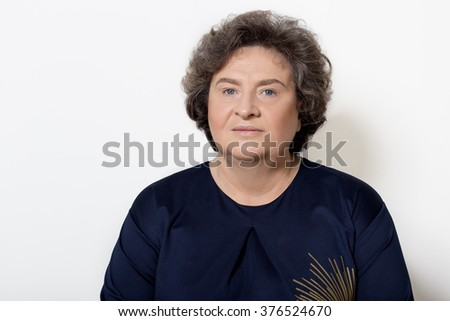 portrait of beautiful elegant woman in a well-kept older srudii on a white background with makeup and without makeup - stock photo