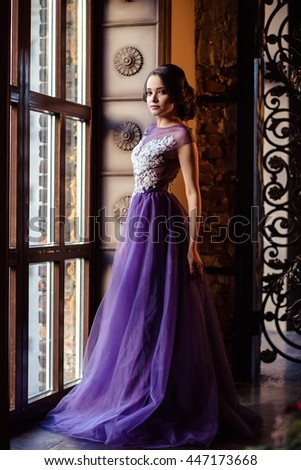 portrait of beautiful elegant young woman in gorgeous evening dress - stock photo