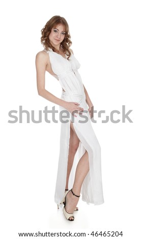 portrait of beautiful european girl posing in long white dress