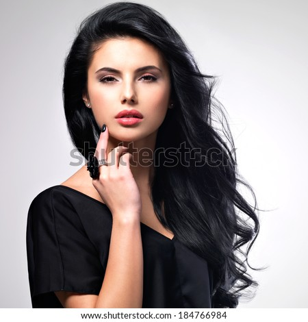 Portrait of beautiful face of an young woman with long brown hair.  - stock photo