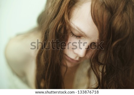 portrait of beautiful face with beautiful closed eyes - stock photo