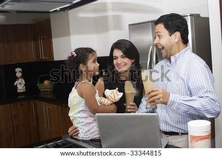 Portrait of beautiful family cooking in kitchen, dad, mom and  daughter