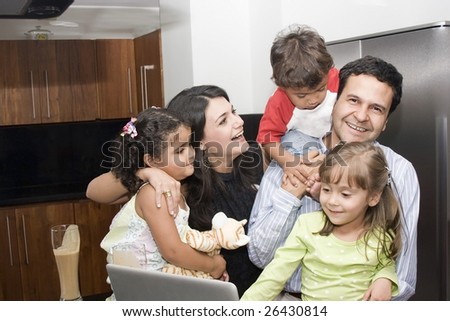 Portrait of beautiful family cooking in kitchen, dad, mom, daughters and little boy