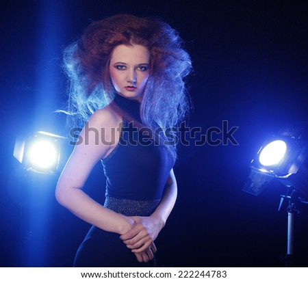 Portrait of beautiful fashion woman model with bright  make-up,  long curly red hair.