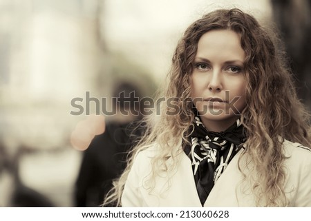 Portrait of beautiful fashion woman with long curly hairs - stock photo