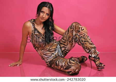 portrait of beautiful fashionable girl in the studio - stock photo