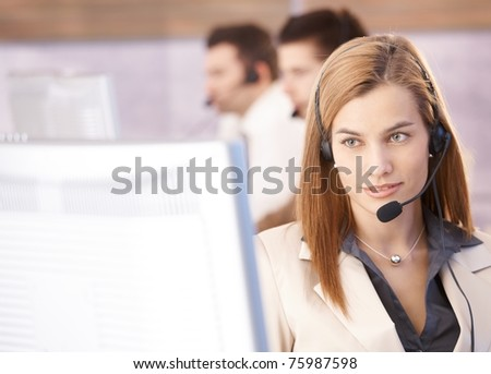 Portrait of beautiful female dispatcher working in call center.? - stock photo