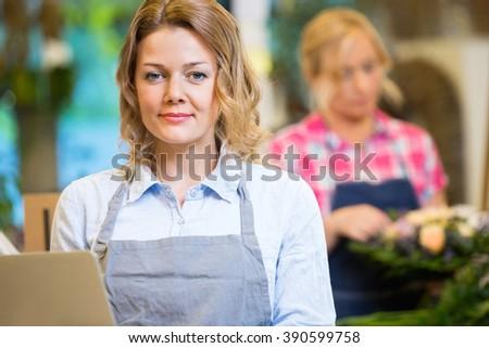 Portrait Of Beautiful Female Florist In Flower Shop - stock photo