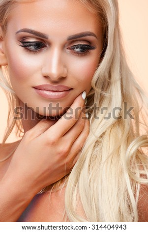 Portrait of beautiful female model on beige background