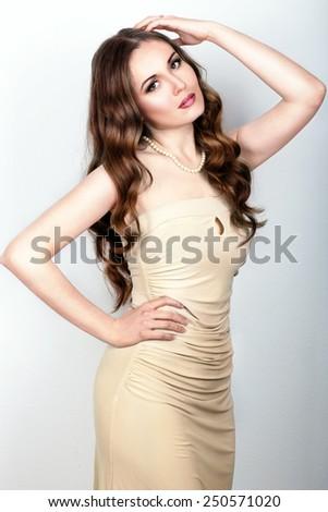 Portrait of beautiful female model on blue background - stock photo
