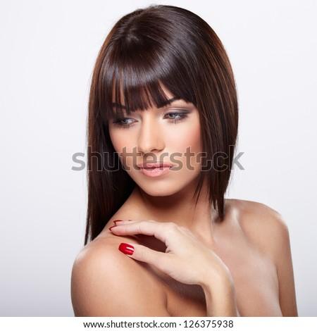 Portrait of beautiful female model on grey background - stock photo