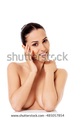 Portrait of beautiful female model on white background.