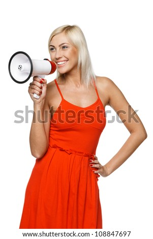 Portrait of beautiful female proclaiming into the loudspeaker to the side, isolated on white background