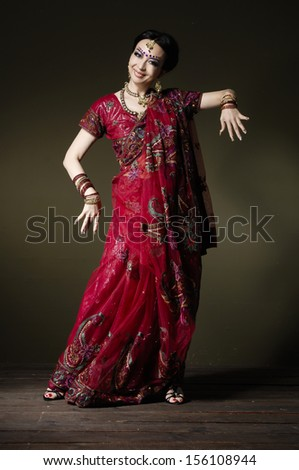 portrait of beautiful female wearing traditional costume, over light background