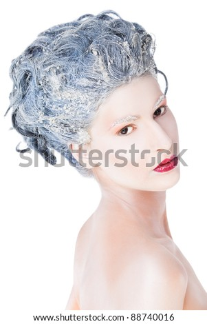Portrait of beautiful female with blue frozen hair on white background