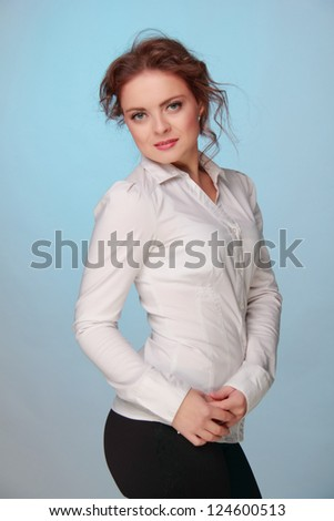 Portrait of beautiful female woman in white shirt