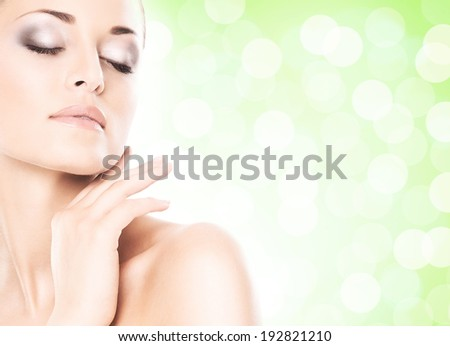 Portrait of beautiful, fresh, healthy and sensual girl over green summer background