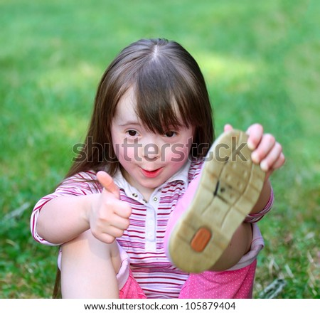 Portrait of beautiful funny girl in the park . - stock photo