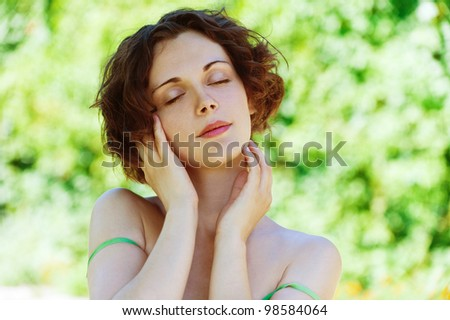 Portrait of beautiful girl close up on green background. - stock photo